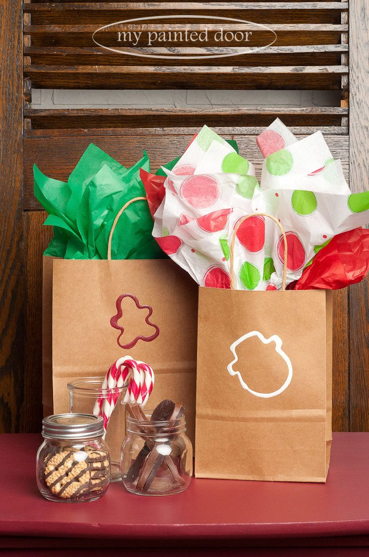Ways to decorate gift bags - Cookie Cutters Dipped In Fusion Mineral Paint Is A Simple Way To Decorate Gift Bags For