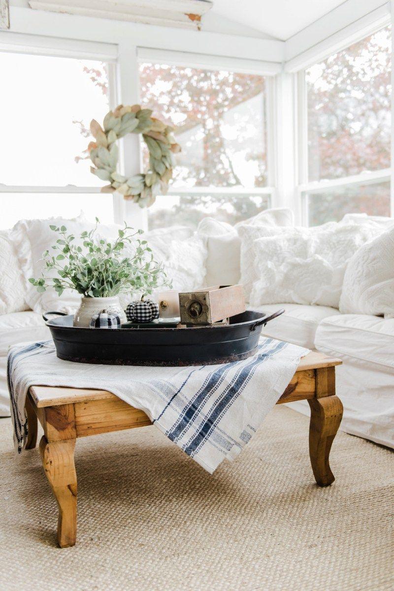 A farmhouse style coffee table in the sunroom farmhouse style