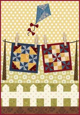 handmade card ... paper pieced scene ... two pieced quilts on a clothesline ... kite floats in the sky above ... luv it!