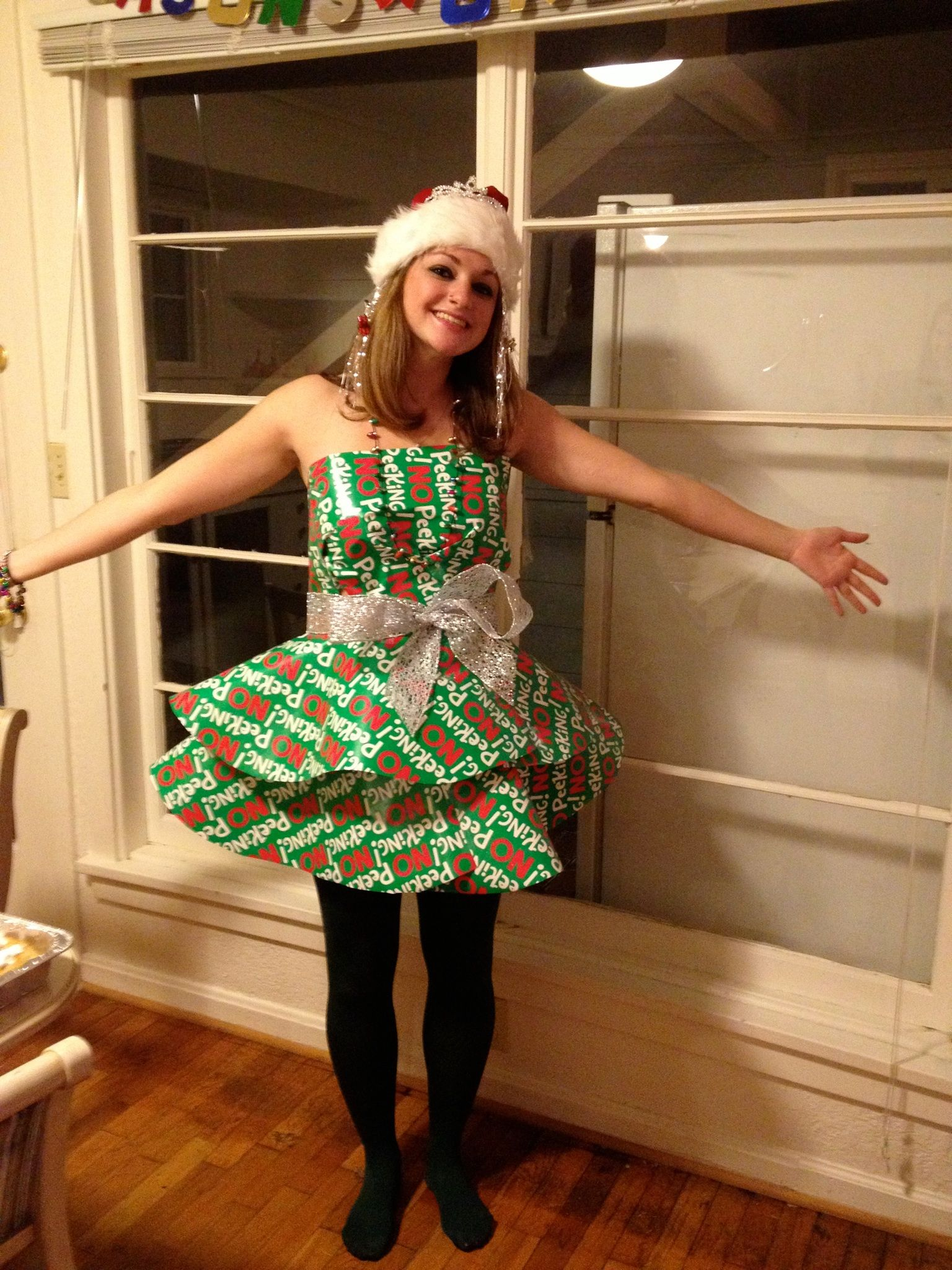 7dfaffb4 Christmas party dress made out of wrapping paper and ribbon! Only took  about 30 minutes to cut out and assemble :)