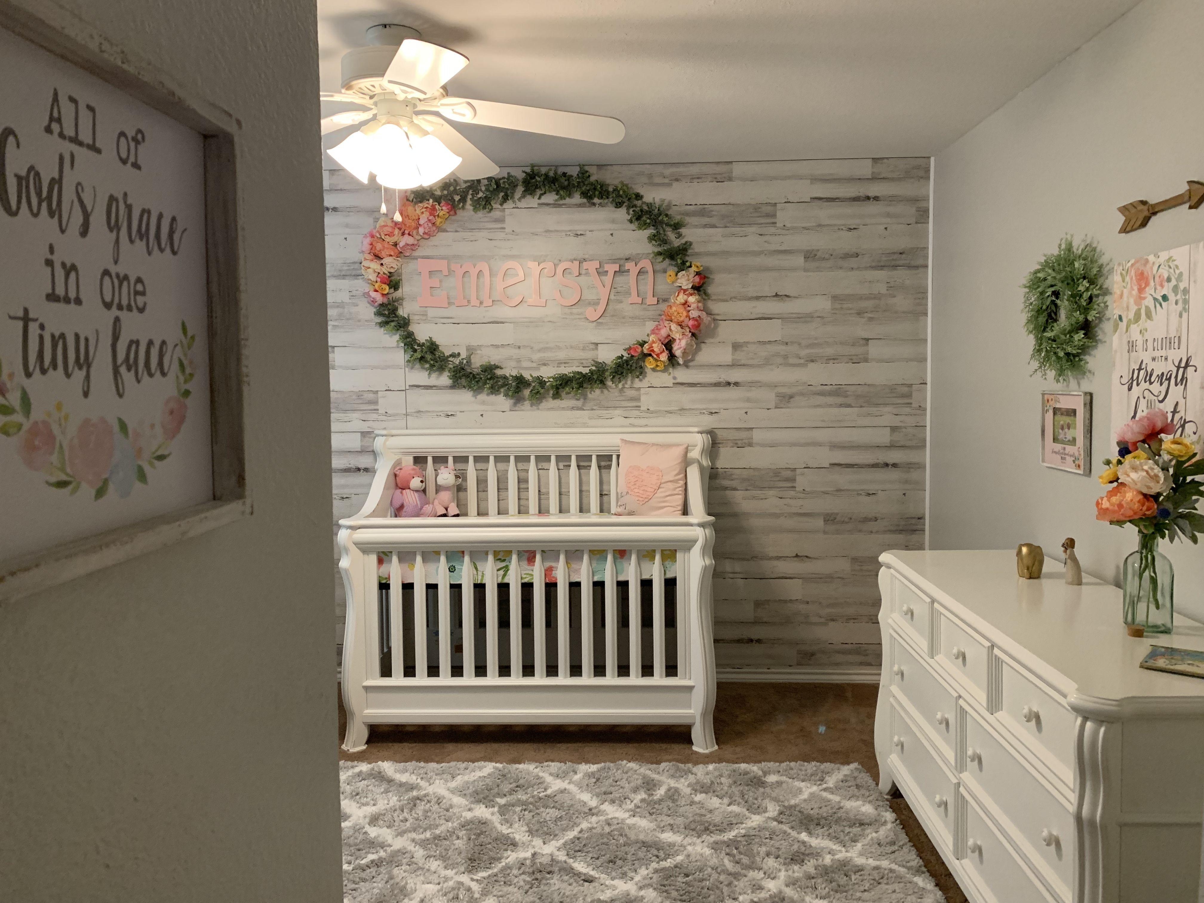 This Subtle Travel Themed Nursery Features A Driftwood Wall Fused With Modern Details Like An Acryl Nursery Room Boy Baby Boy Room Nursery Neutral Kids Bedroom