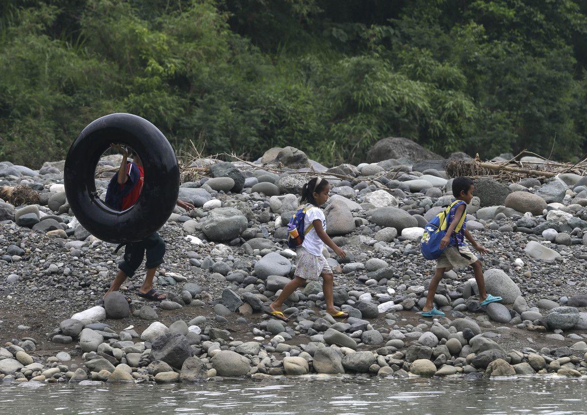 Crossing a swollen river to get to school