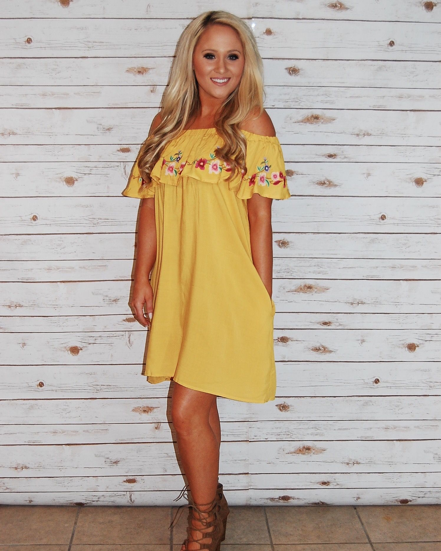 This is the perfect dress to get you in the mood for spring! 🌼 www.champagnewishesbtq.com