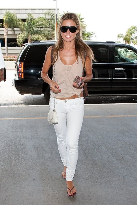 9c5ce1dde Audrina Patridge wearing Divine Rights of Denim Jealousy Sandal Cut Skinny  Jeans Chanel chain bag Departing from Lax Airport July 7 2011