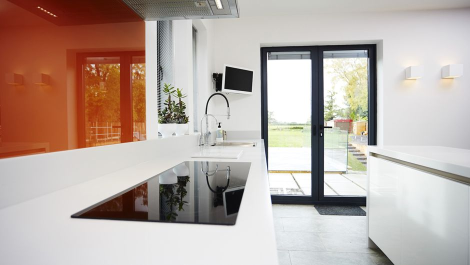 Architectural White Kitchen With Orange Splashback By Trukitchen