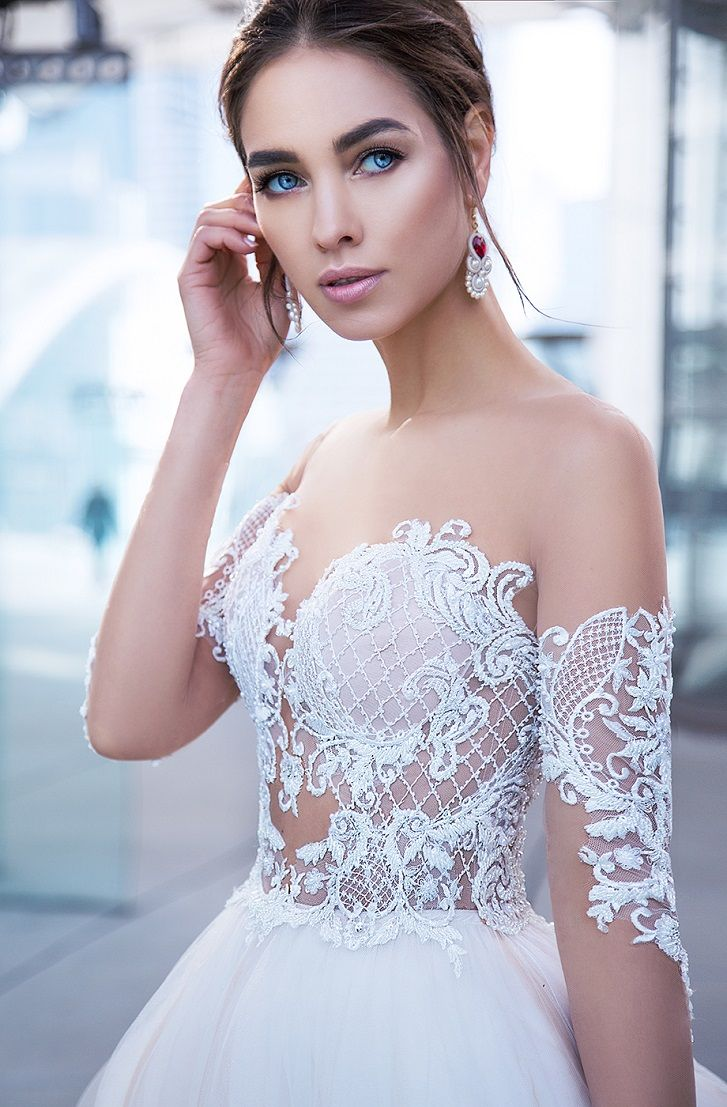 lace sleeves flowing from the shoulders and delicately touching the elbows sweetheart neckline ball gown wedding dress #wedding #weddingdress #weddinggown