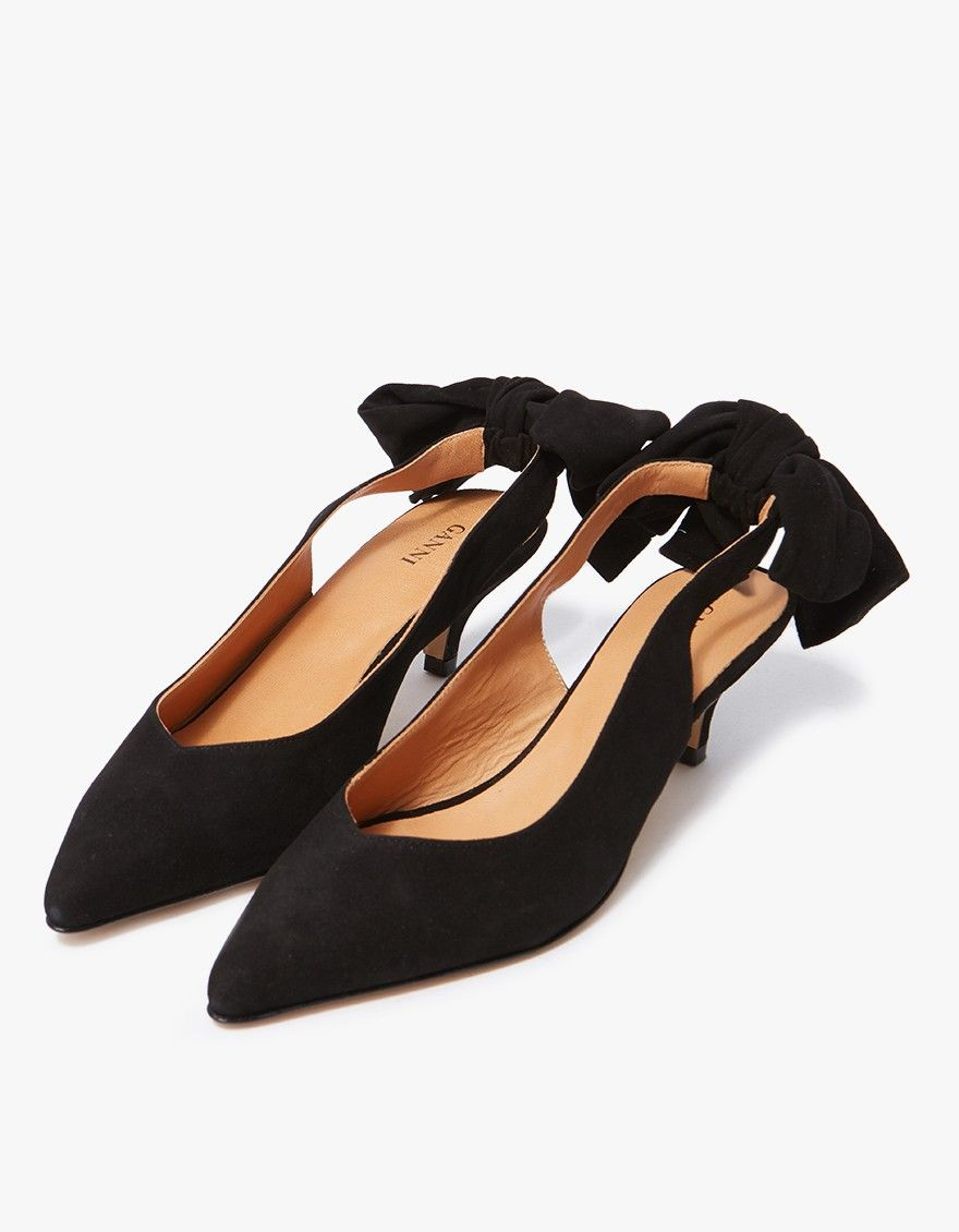 6f8d699939f7 Slingback pumps from Ganni in Black. Goat suede upper. Pointed toe.  Slingback strap with bow detail. Leather lining. Tonal stitching.