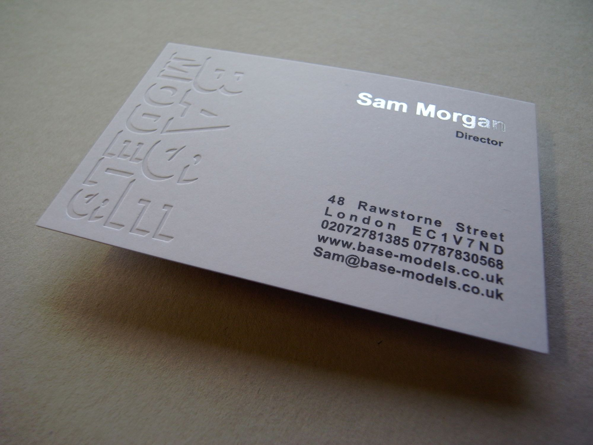 Base Business cards printed clear & silver foil and grey
