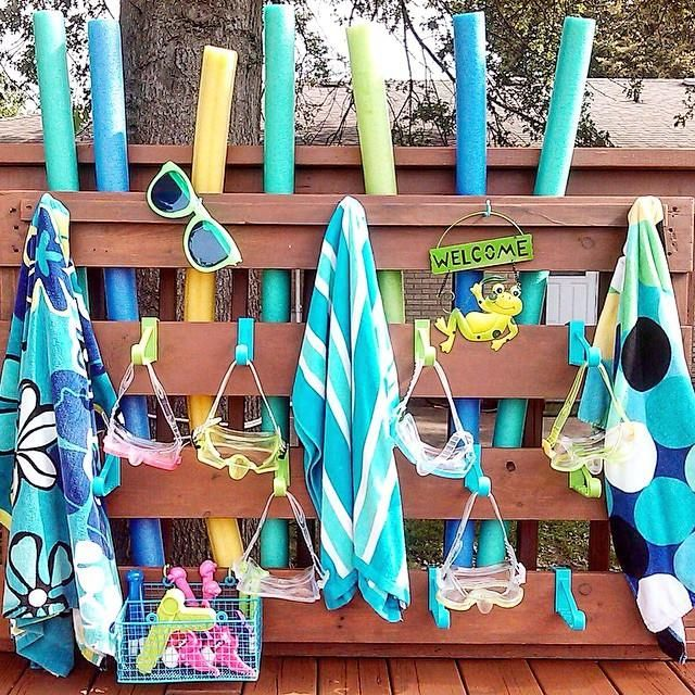 Pool supplies organizer made from an upcycled pallet for Above ground pool storage ideas