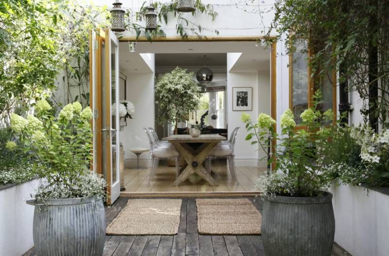 Gorgeous Rustic Dining Room Leadin Through French Doors Onto A Beautiful Terrace