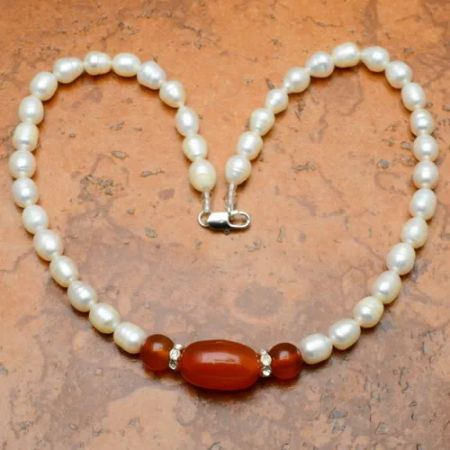 Carnelian and cultured pearl beads necklace with 14 karat gold closure.