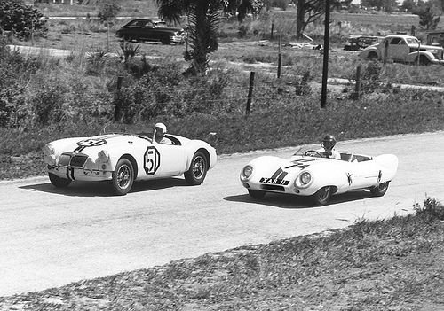 MG & Lotus at Sebring 1957  The MG A of David Ash, Gus Ehrman and John van Driel about to be passed by the Lotus Eleven Le Mans of Doc Wyllie, Margaret Wyllie and Charles Moran.  The Lotus was disqualified for getting assistance on the track while the MG A finished 27th.