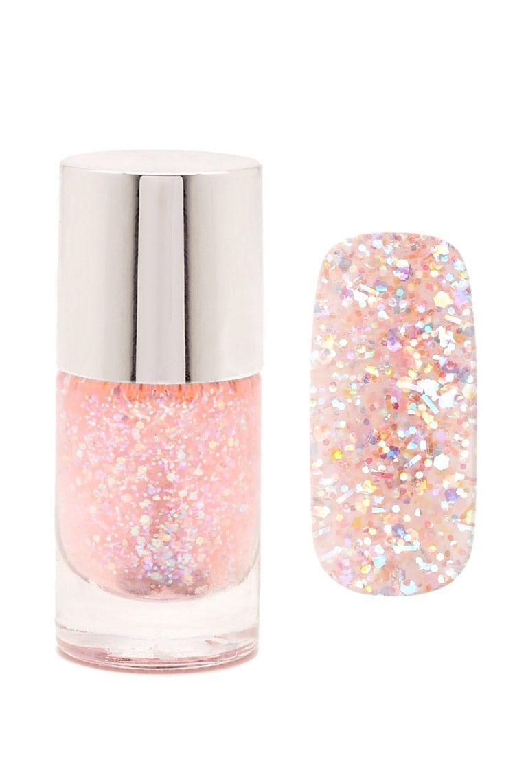 A semi-sheer nail polish featuring allover iridescent glitter flakes ...