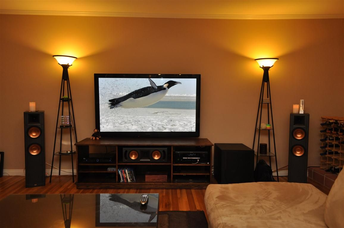 I want something more like this; cleaner home theater look; less cheap center TV stand