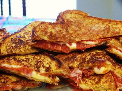 pizza grilled cheese: 4 slices of bread buttered, 4 slices of mozzarella cheese, pepperoni, italian seasoning or basil, parmesan cheese, & pizza sauce for dipping -- sinfully delicious