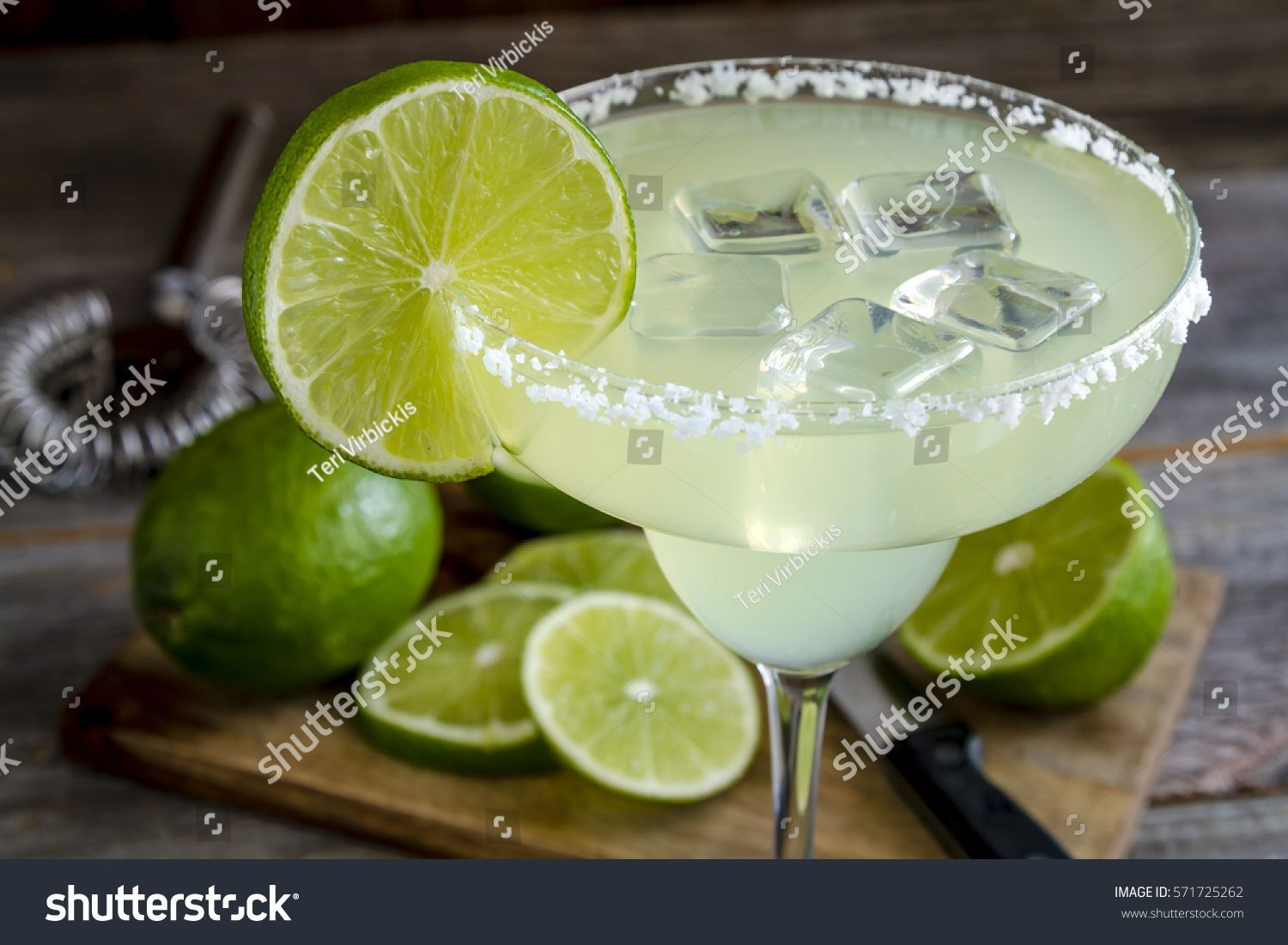 Classic lime margarita cocktail with sliced and whole limes sitting on wooden cutting board #Sponsored , #AFFILIATE, #cocktail#sliced#margarita#Classic #limemargarita Classic lime margarita cocktail with sliced and whole limes sitting on wooden cutting board #Sponsored , #AFFILIATE, #cocktail#sliced#margarita#Classic #limemargarita