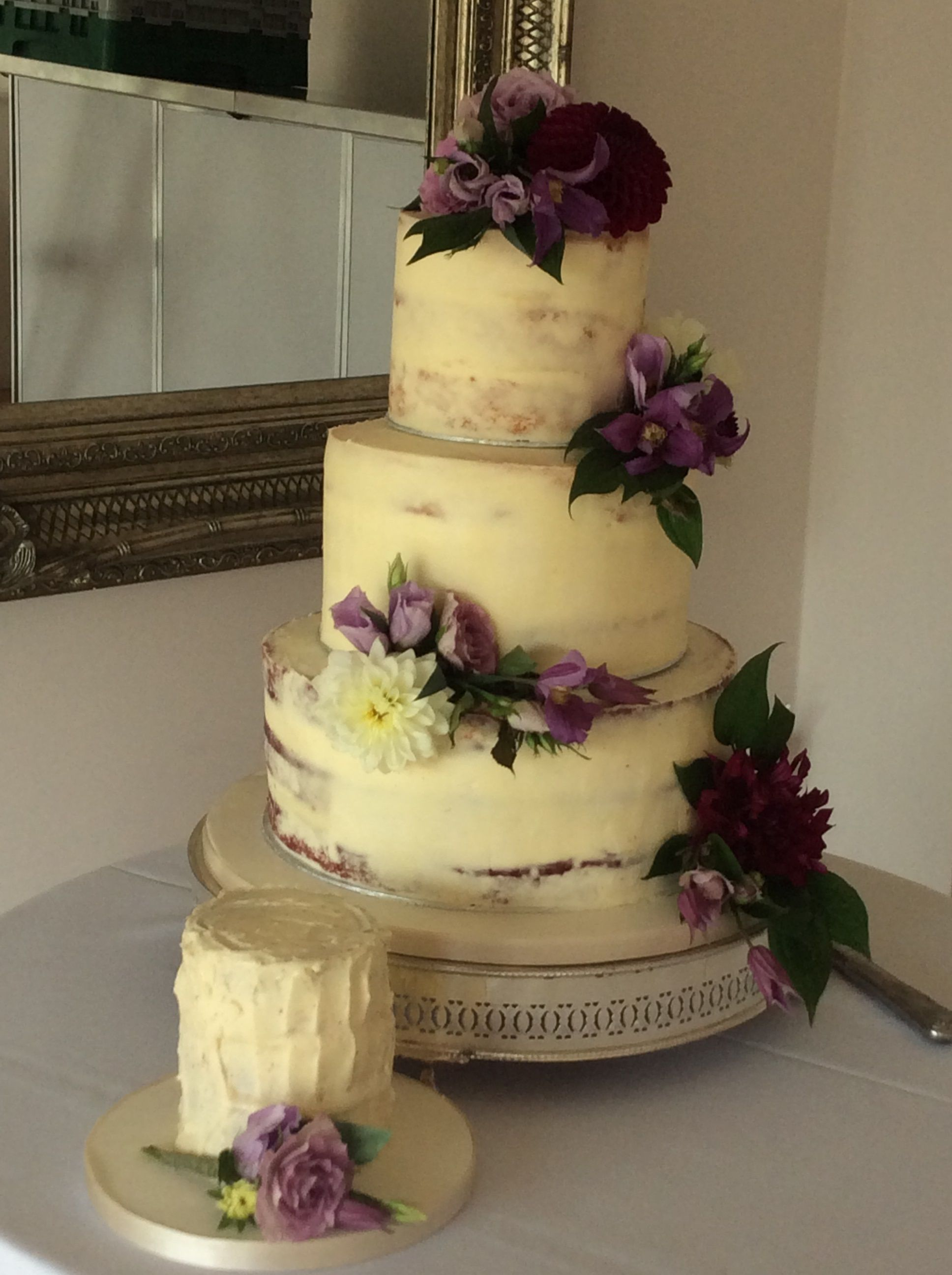 3 tier semi naked cake with autumnal flowers in rich jewel tones ...