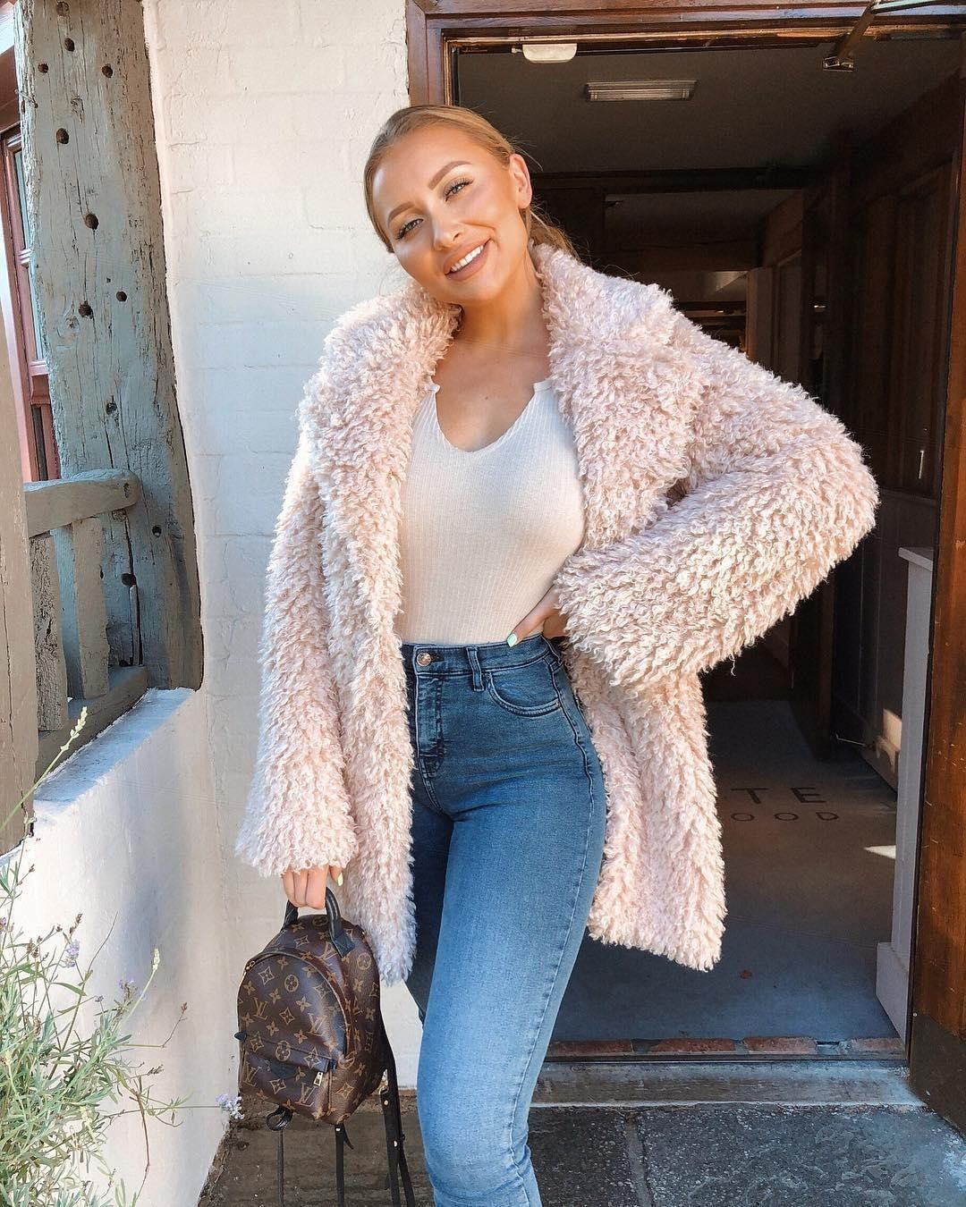 b50a9d1096 FUR SEASON 💕🐻 Obsessed with @sarahhashcroft in the White rib button top,  Mid wash split hem jeans & Stone teddy faux fur coat 😍😍 Tap to shop 🙌
