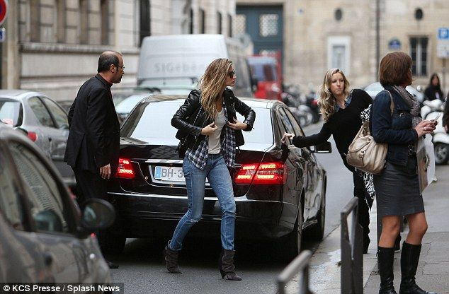 Gisele Bundchen steps out with damp hair as she dashes to photoshoot #dailymail