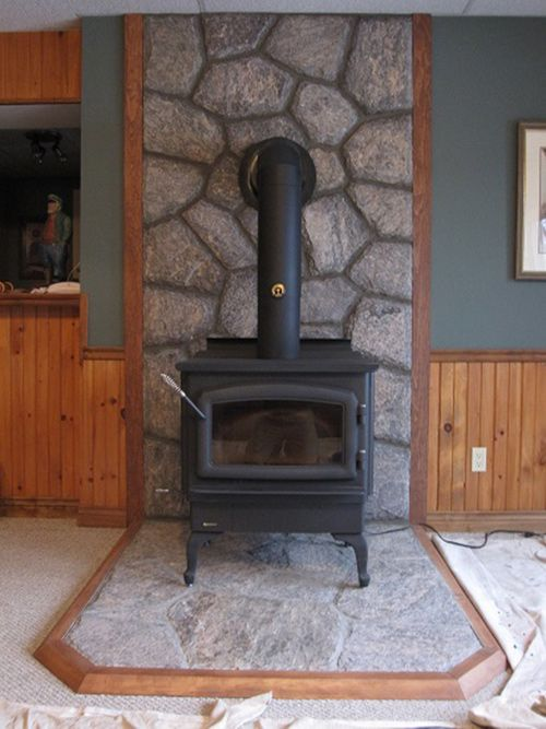 regency wood burning stove with 5 point granite hearth and backsplash efficient wood