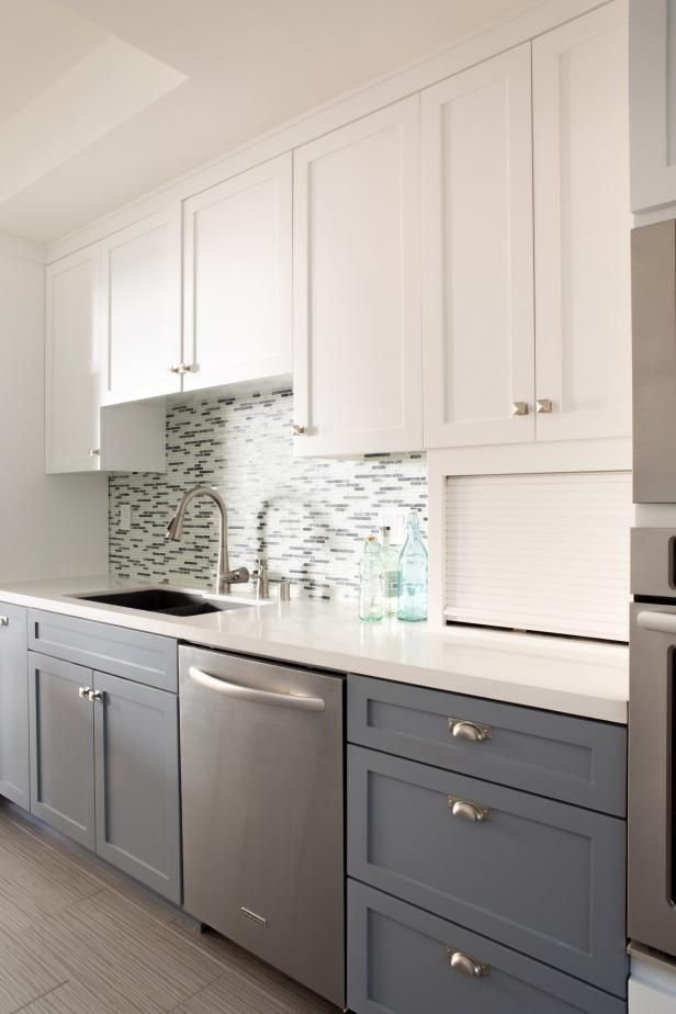 two tone kitchen pantry features white upper cabinets and gray