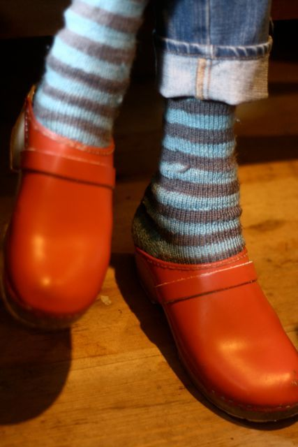 red clogs, hand-knit socks