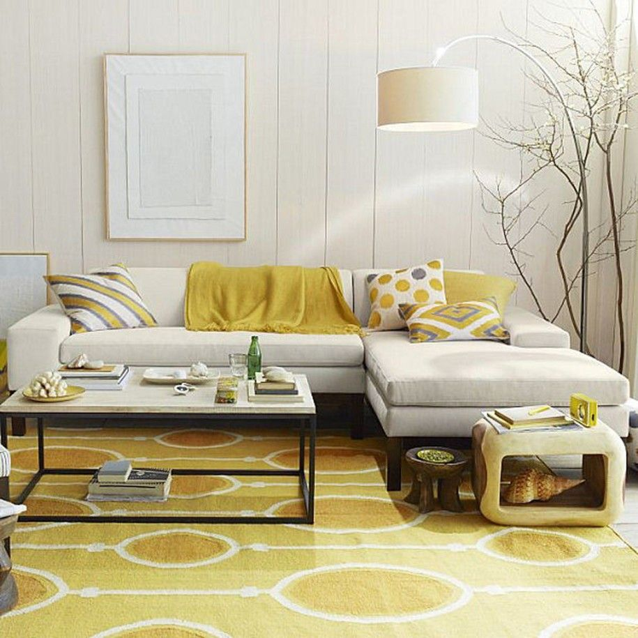 Cream and mustard yellows in this California casual living room. sectional, rug, paneled walls