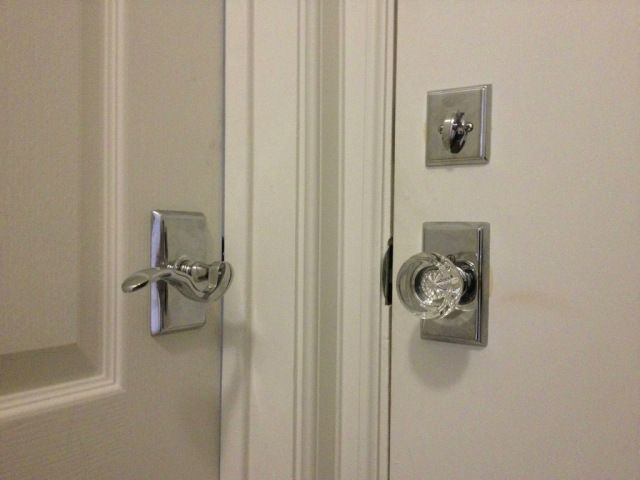 Mixing crystal & lever doorknobs. Matching backplates make this ...