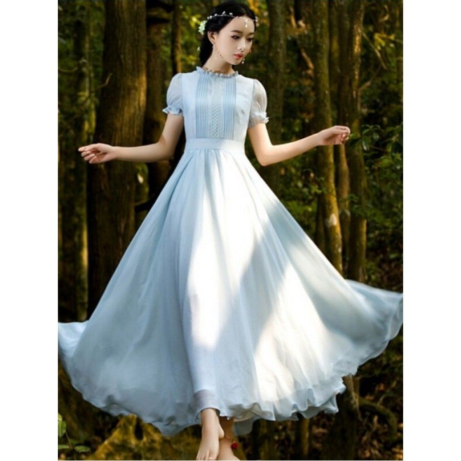 Stunning long blue chiffon summer dress featuring folded pleat and