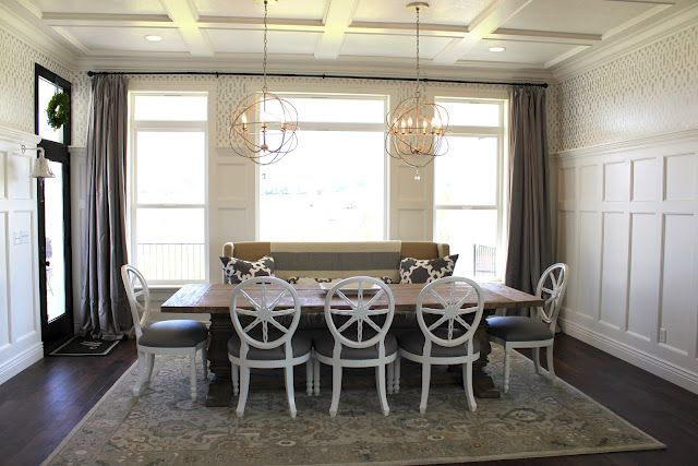 Double Orb Chandeliers In Dining Room