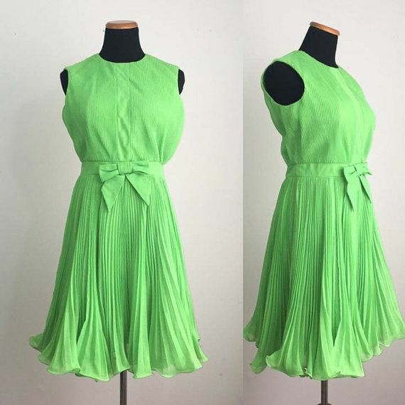 Youll light up the room in this neon green number. Accordion pleated bodice & skirt. Bow at the waistband. Nylon zipper down the back.