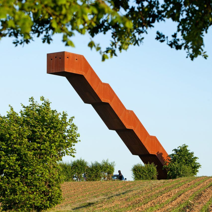 This weathering steel staircase appears to defy gravity by cantilevering off a hilltop in Flanders. Designed by Belgian studio Close to Bone, the lookout point at the top of Vlooyberg Tower offers views over the rolling farmland and a nearby forest.