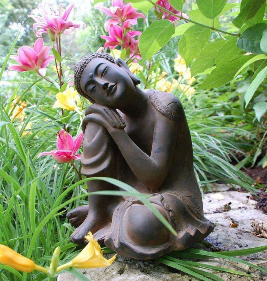 Garden With Flower Plants And Buddha Statue
