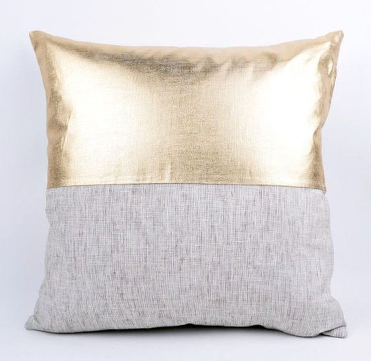 Sew pillow case made of fabric and synthetic leather in gold