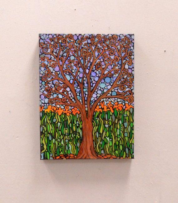 Baum mit Orange Schwertlilien