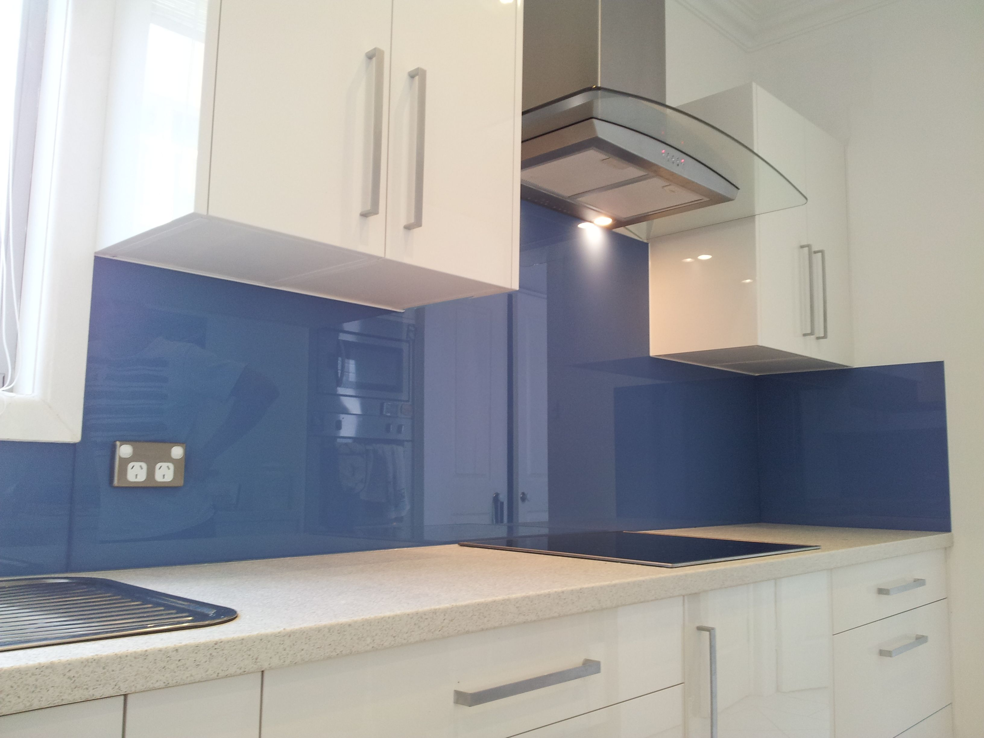 This calming blue splashback is the perfect pairing to a white and ...