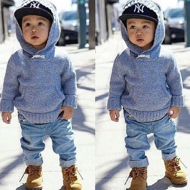 This little cutie is wearing a hoodie and Timberlands. Cute