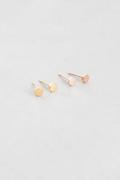 Dainty circle gold and rose gold tiny stud earrings that are perfect on the go!