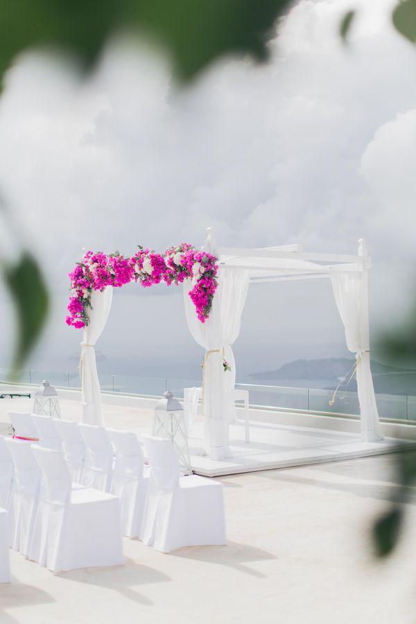 Elegant bougainvillea wedding in Santorini