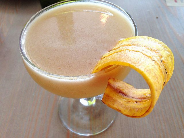 Sunny Spot cocktail Platano Suave with plantain garnish!