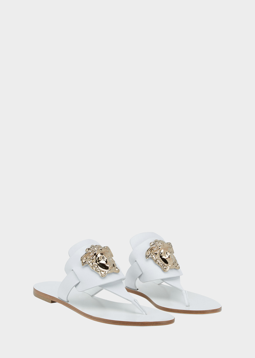 f76013b92dc114 Palazzo Flat Thong Sandals from Versace Women s Collection. Crafted in soft  leather and embellished with
