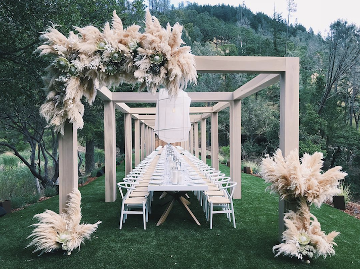 Pampas Grass Is The Underrated Plant Every Outdoor Wedding Needs Beach Wedding Flowers Grass Wedding Wedding Decorations