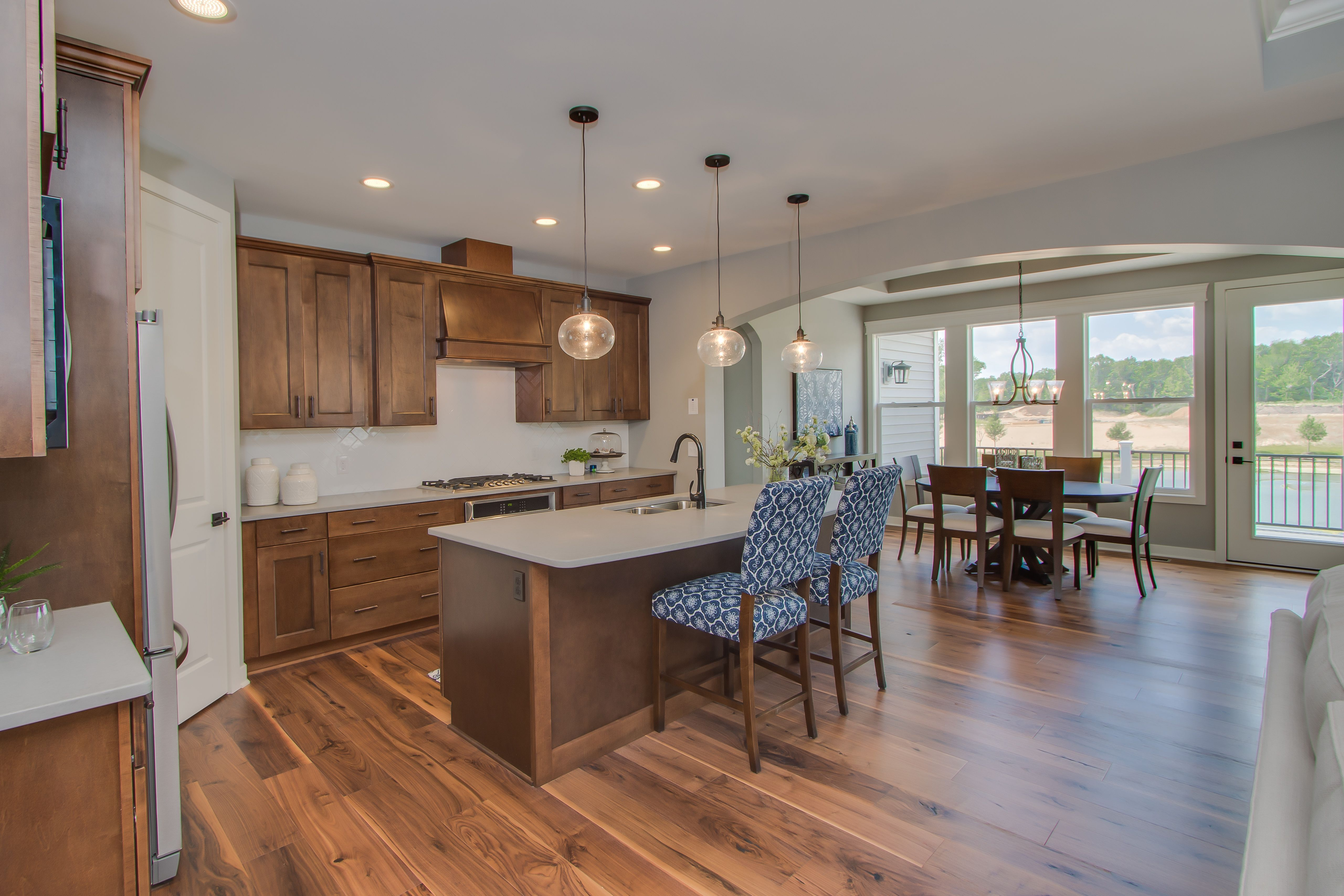 Kitchen with view into Dining Area: Walnut hardwood floors ...