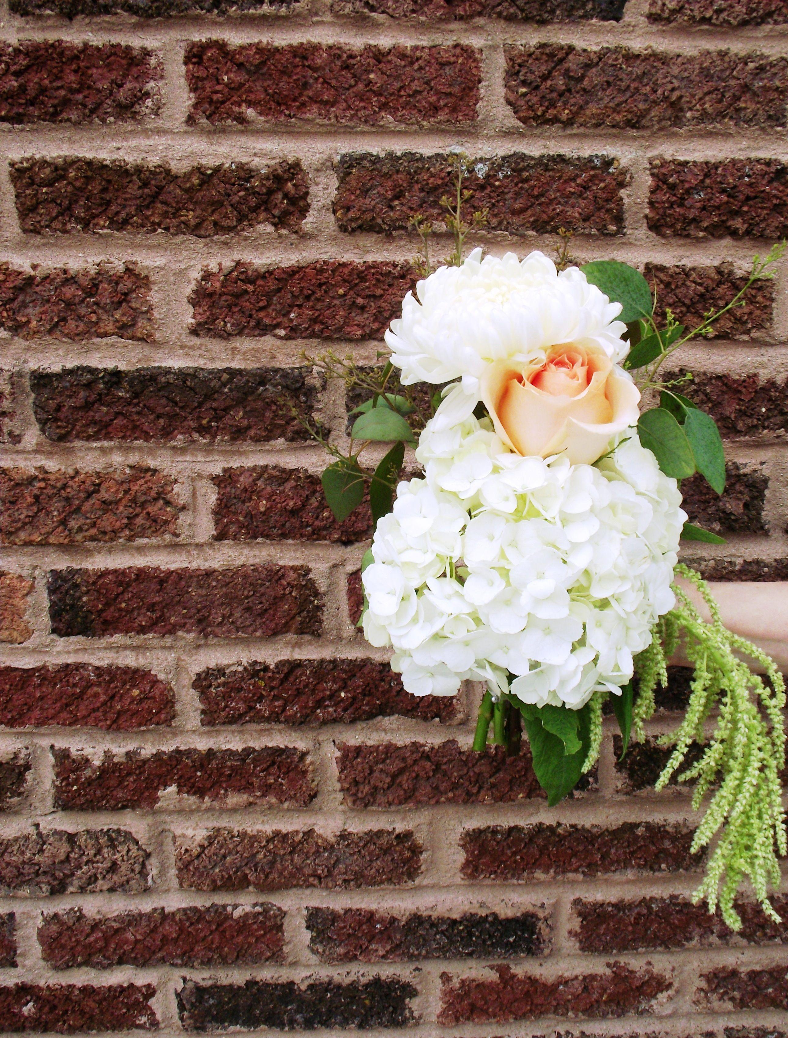 bridal bouquet of peach garden roses, white hydrangea, fluffy ...