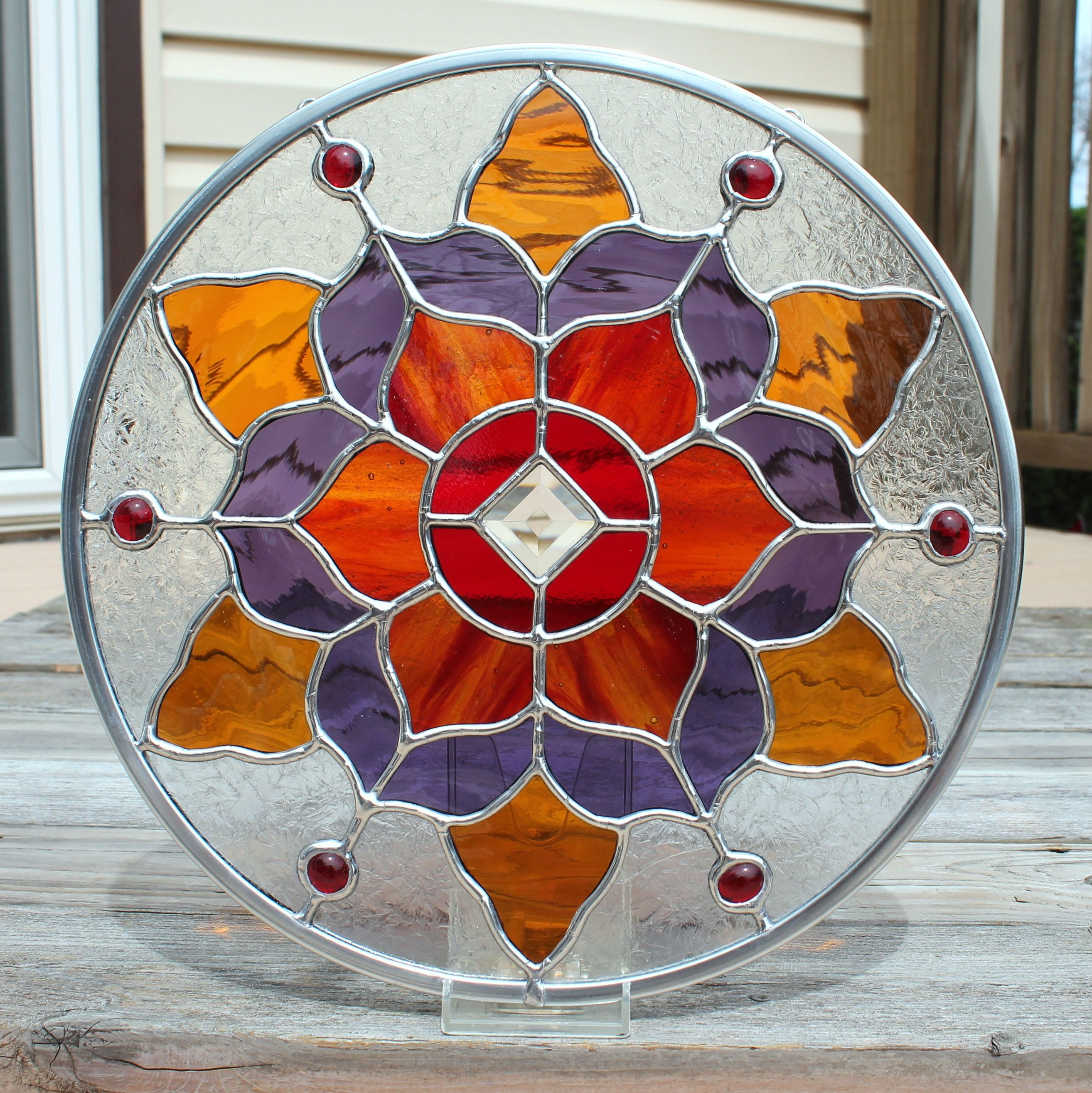 Round Stained Glass Panel In Reds Amber And Purple Vitray