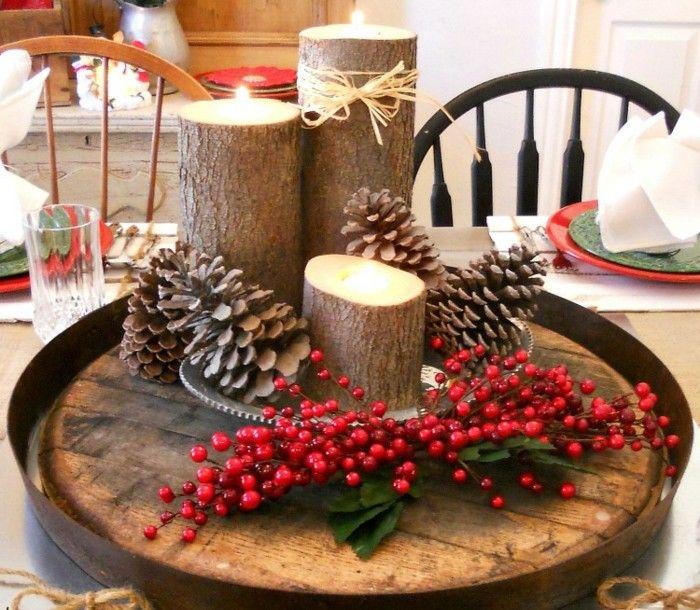 un centre de table magnifique decoration de noel a fabriquer soi meme bougeoirs representant des buches de bois un centre de table magnifique