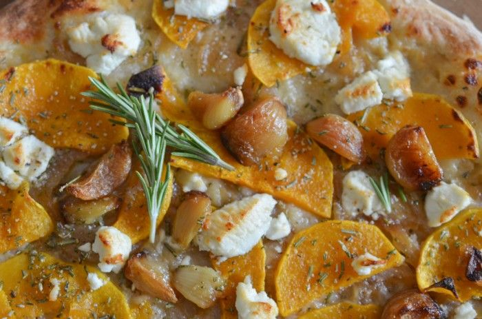 Roasted garlic, butternut squash and goat cheese pizza with caramelized onion and rosemary