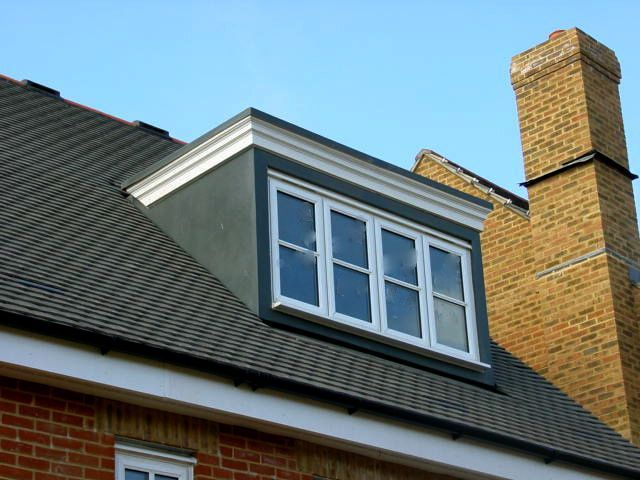 Flat roof dormer with windows stretching across loft for Dormer designs