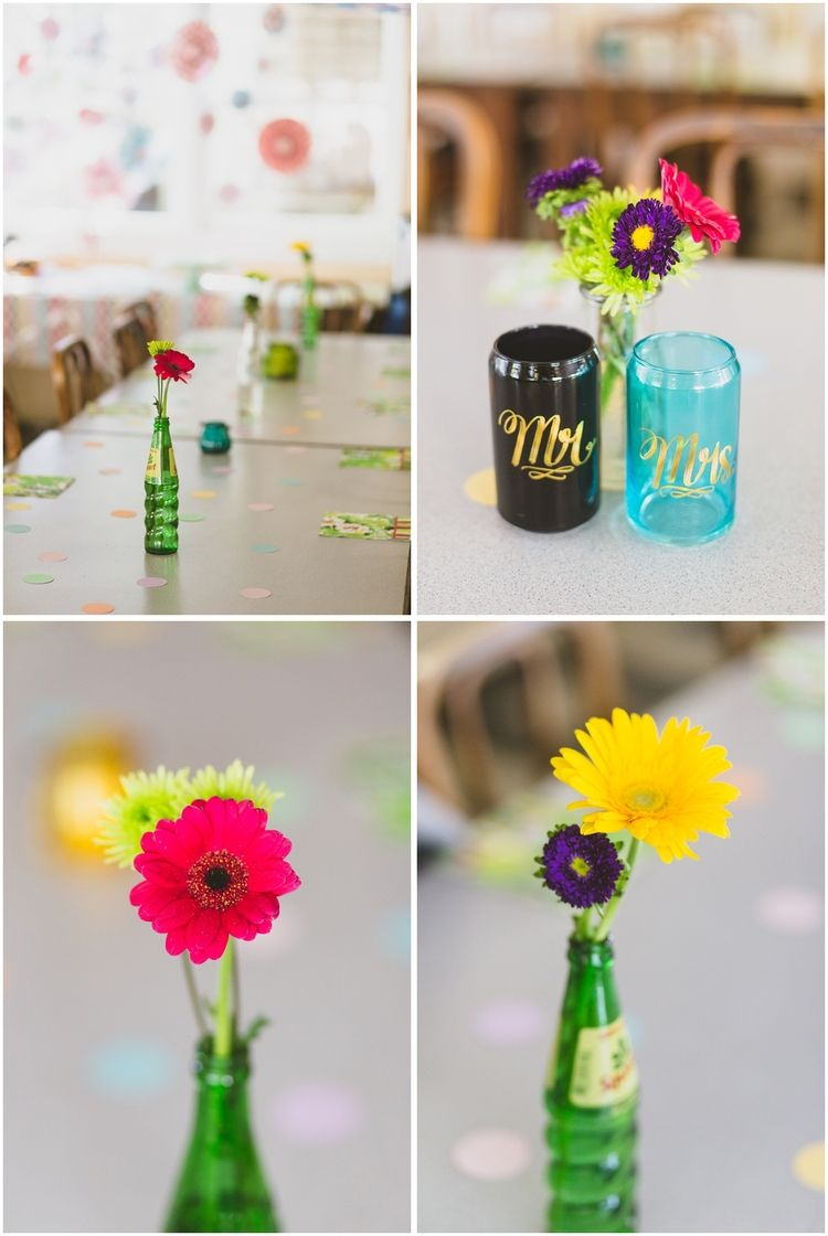 nature friends los angeles fine art wedding photographer_colorful reception decor with bright flowers in recycled bottles_mr and mrs glasses