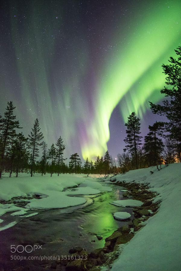 Auroras over Kakslauttanen by sjtm Auroras blazing over river Kakslauttanen in Sodankylä Finland